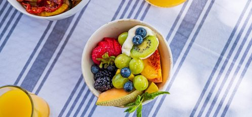Breakfast Bowls on table with orange juices